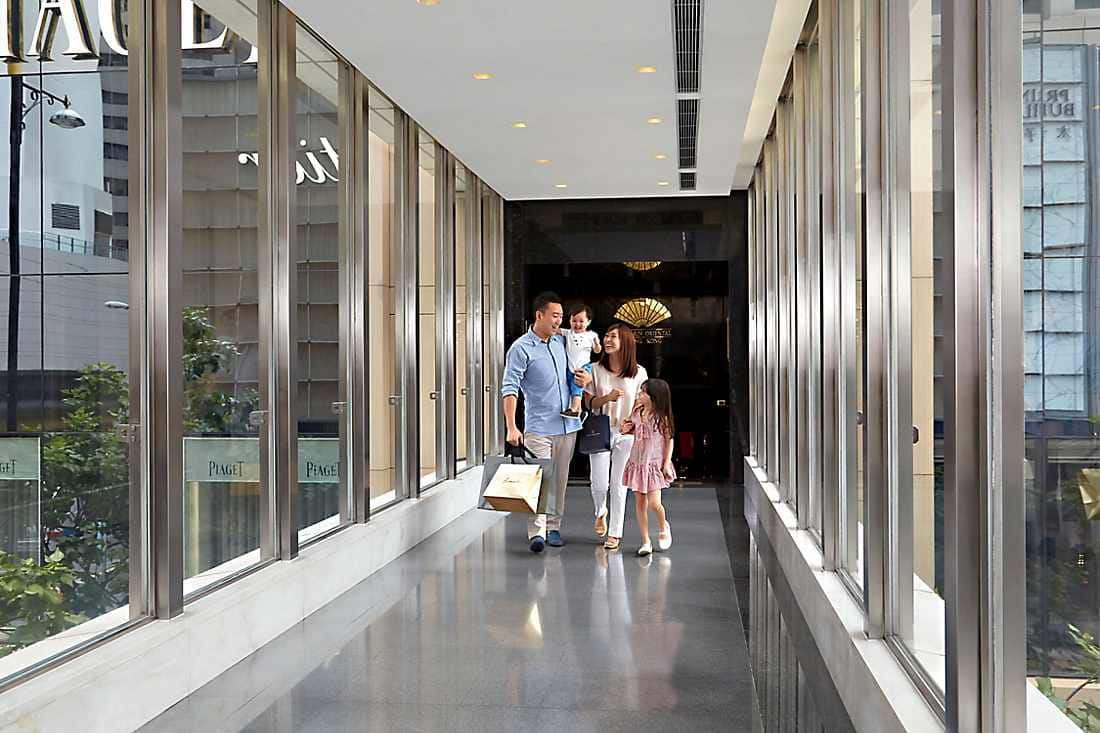 family walking to shopping mall next to mandarin oriental, hogn kong