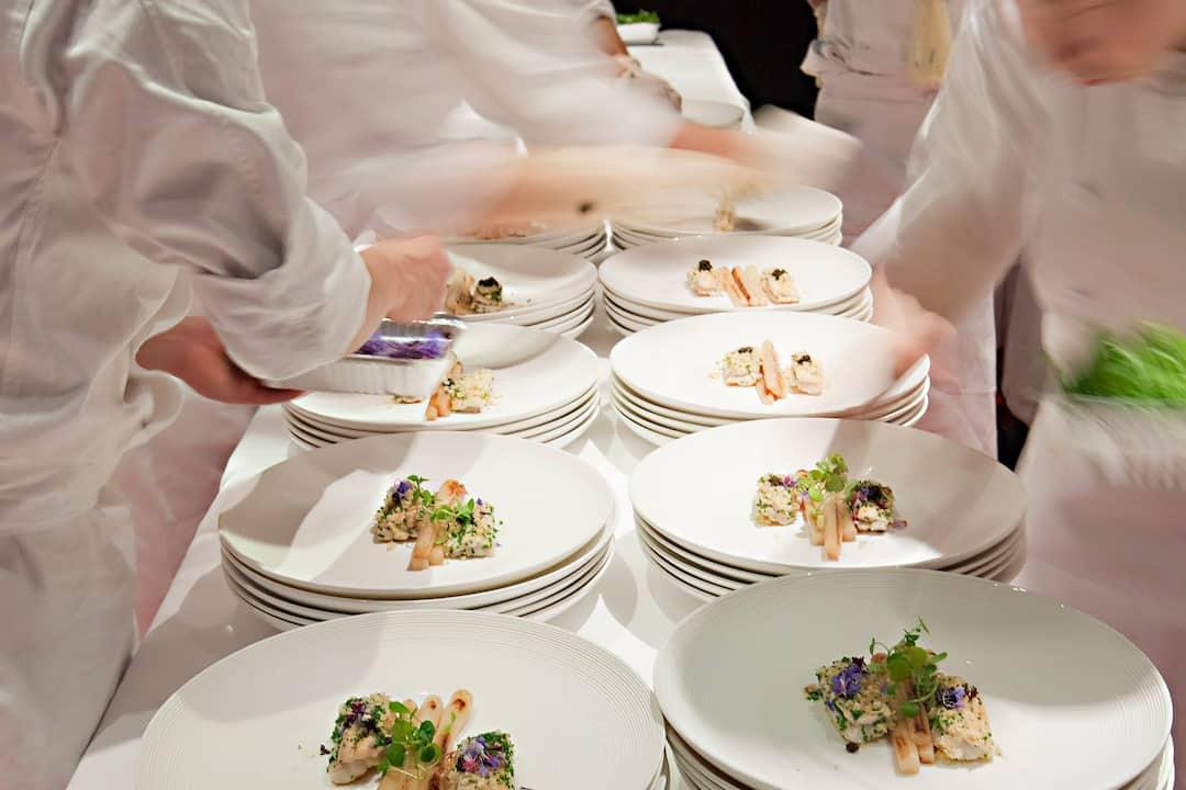 catering team preparing dishes at mandarin oriental, hong kong