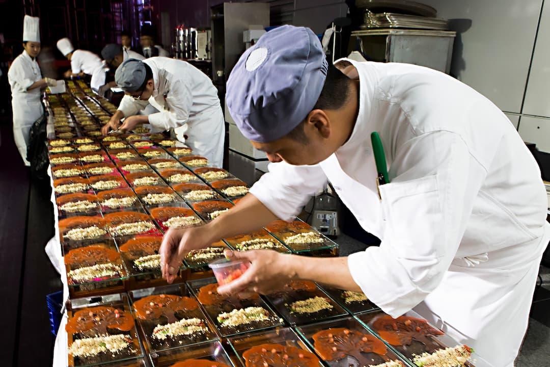 catering team preparing canapes at mandarin oriental, hong kong