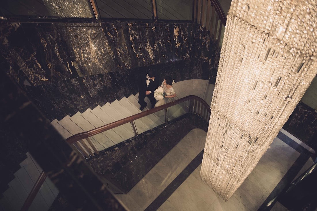 wedding couple on staircase at mandarin oriental, hong kong