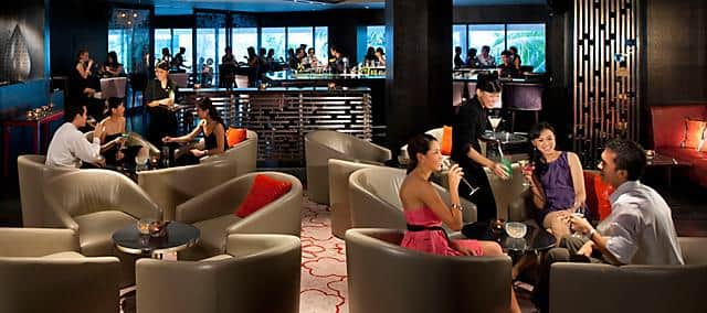 a group of guests having drinks in mo bar at mandarin oriental, jakarta