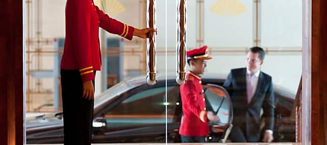 valet greets and opens the car door for guest at mandarin oriental, jakarta