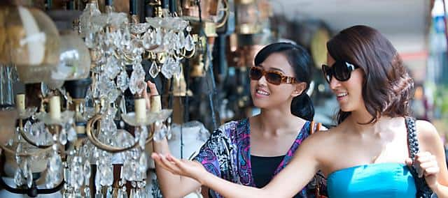 two women with sunglasses shopping on the street in jakarta