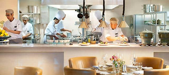 open kitchen in the restaurant with chefs at mandarin oriental, jakarta