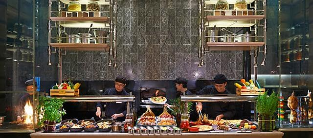 chefs and staffs preparing food at the buffet