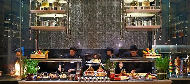 chefs and staffs preparing food at mosaic at mandarin oriental, kuala lumpur