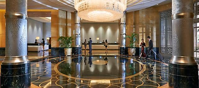 hotel lobby with large pillars and reception desk at mandarin oriental, kuala lumpur