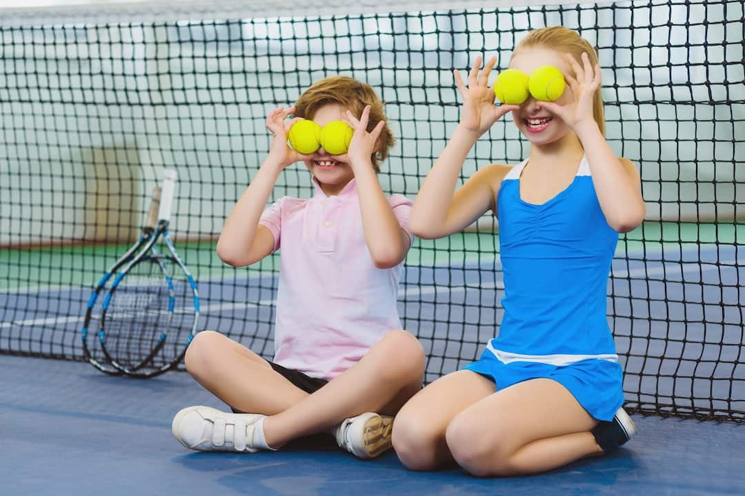 kids having fun with tennise ball