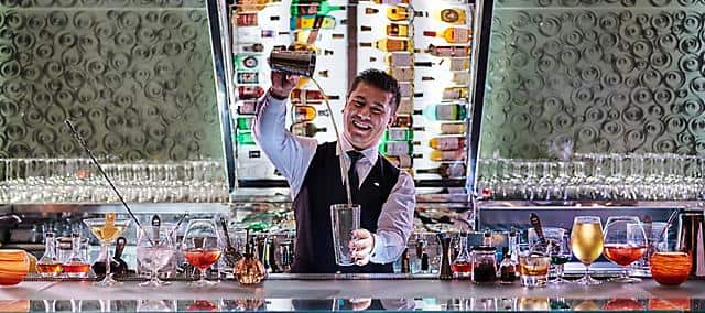 bartender at mo bar at the landmark mandarin oriental, hong kong