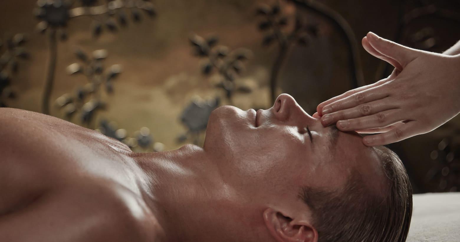 man having head massage