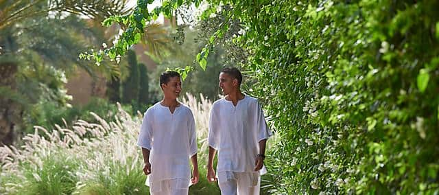 two hotel staff walking and smiling