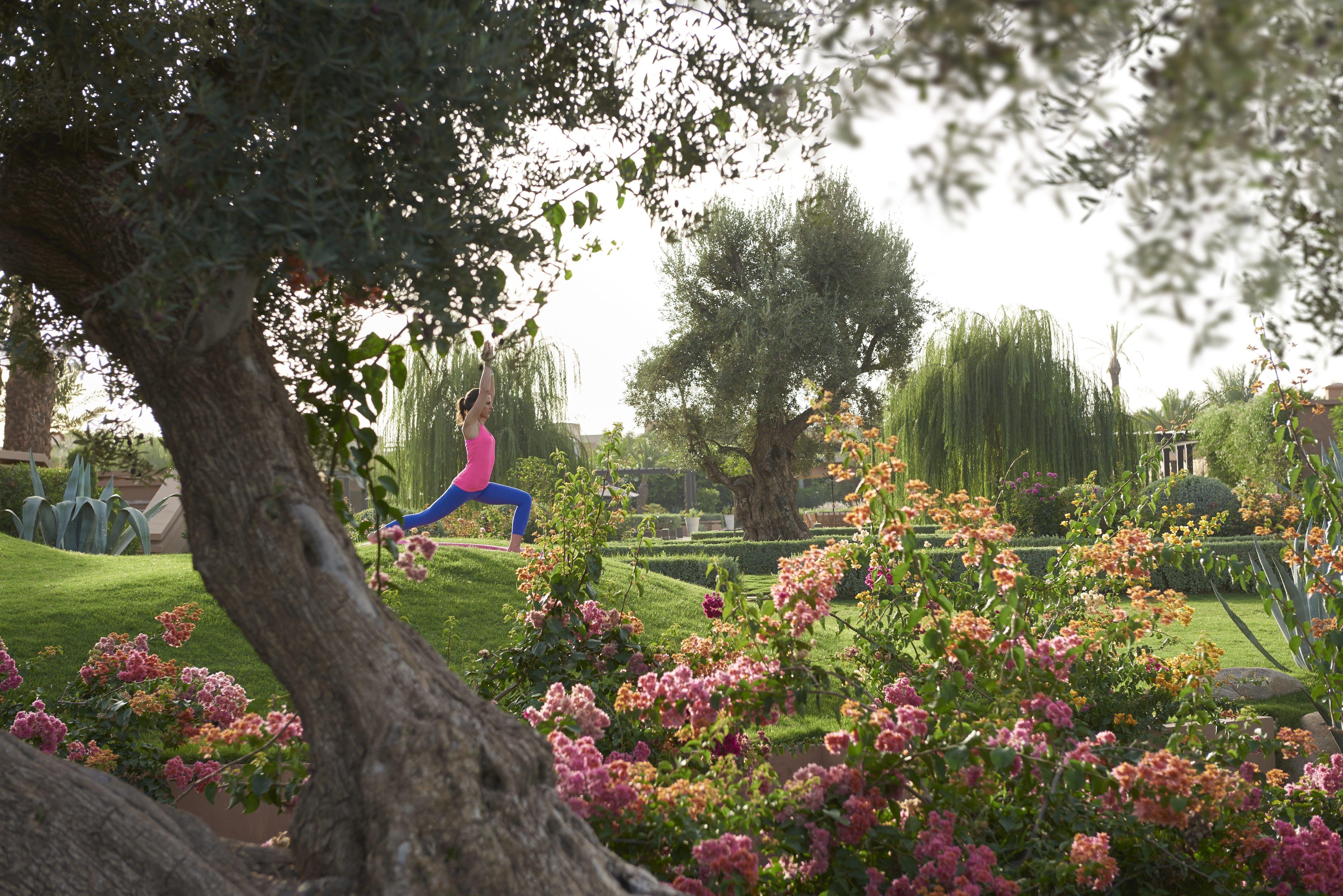 Woman practises yoga in garden