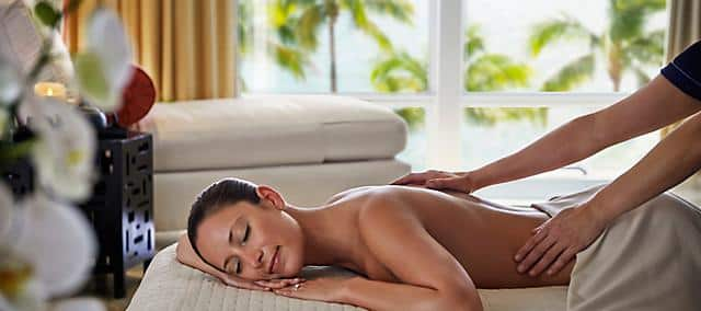 a woman relaxing on spa bed while enjoying a massage