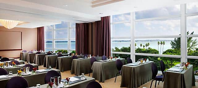 meeting room with purple chairs and desks overlooking the ocean
