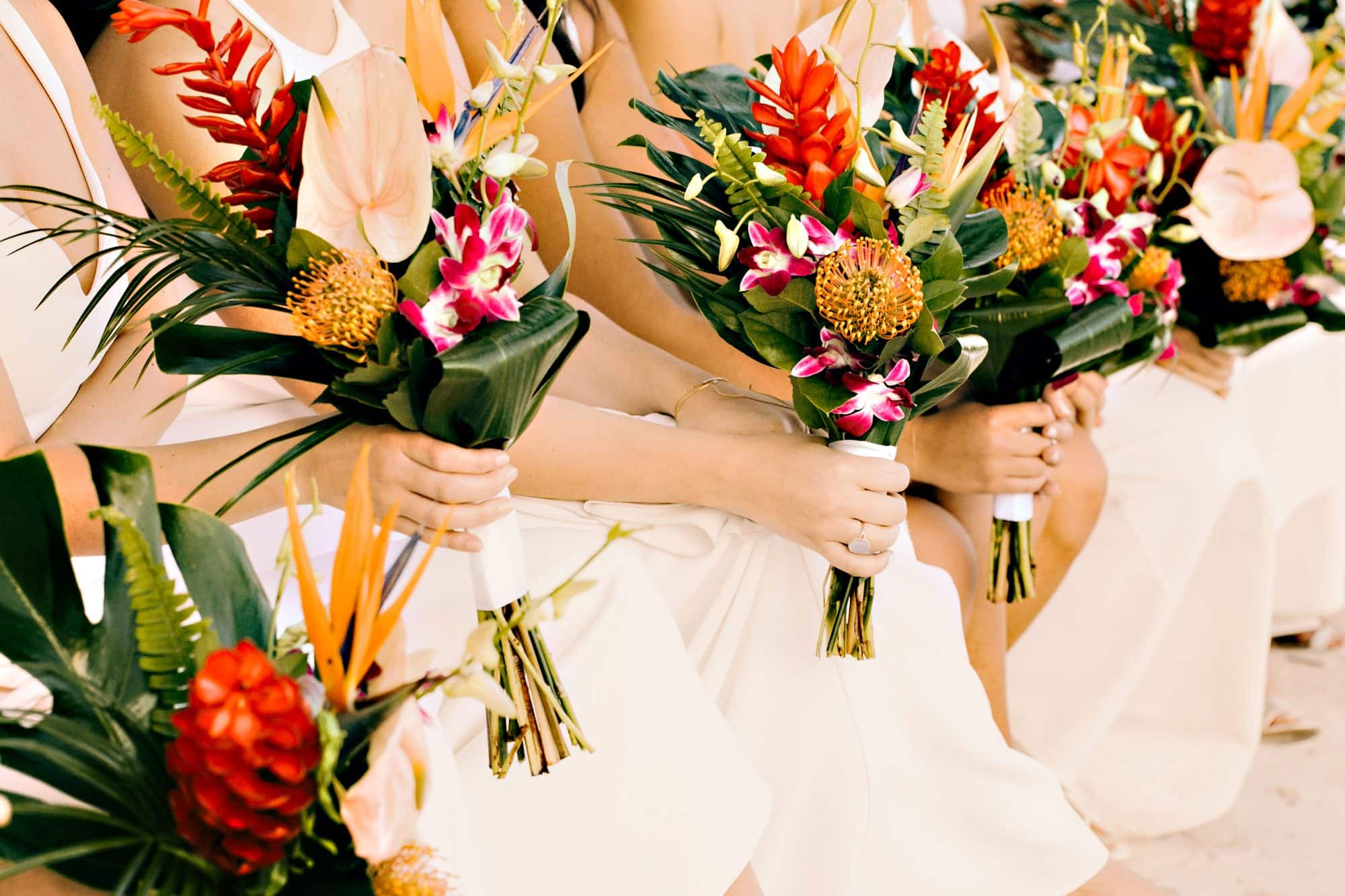 Bridal party holding flowers