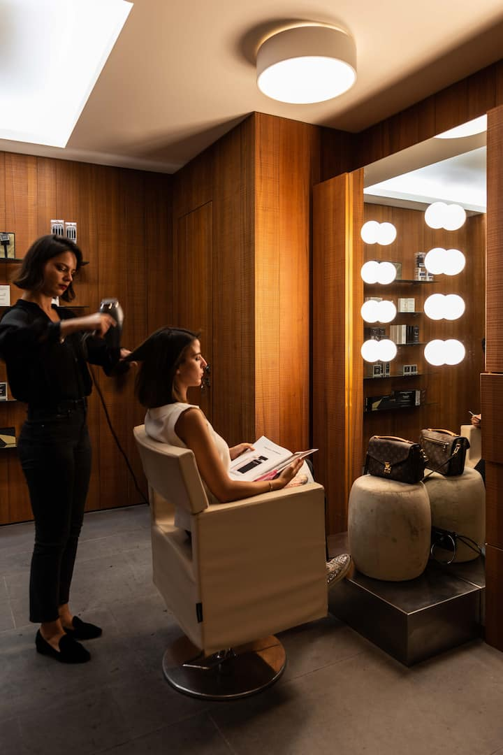 hair stylist giving service to a guest