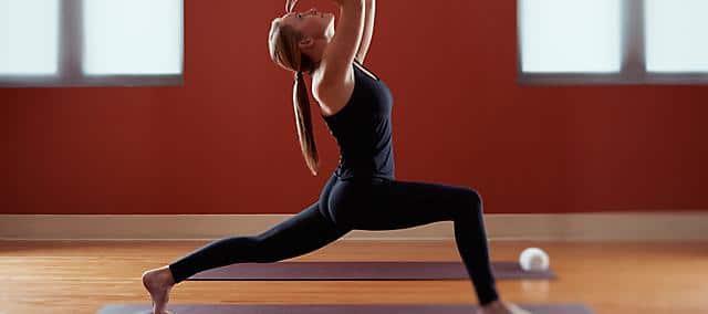 doing yoga in fitness center