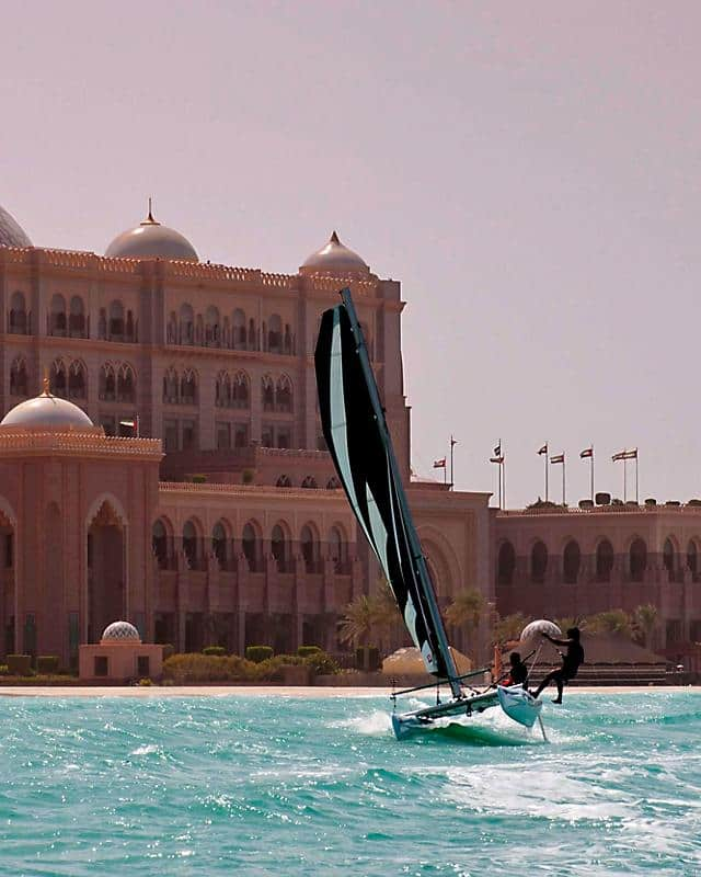 Emirates Palace hotel from sea with windsurfer