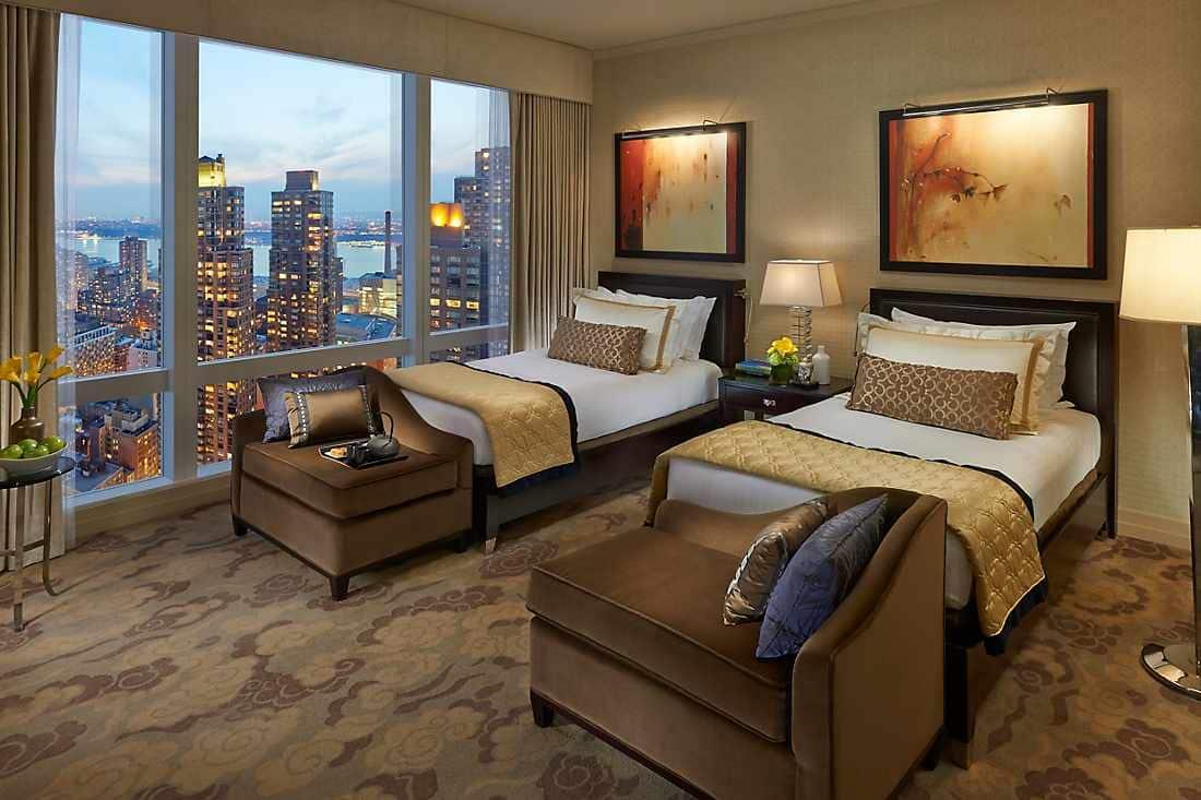 Mandarin New York skyline view room beds