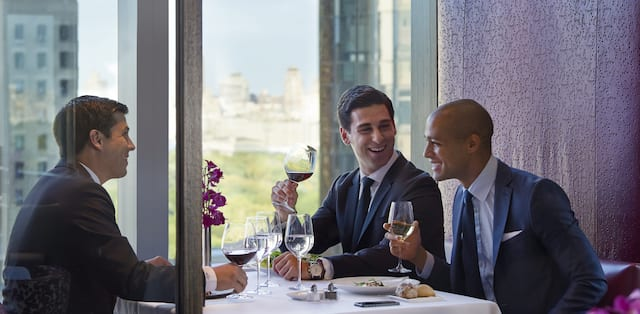 three men drinking wine