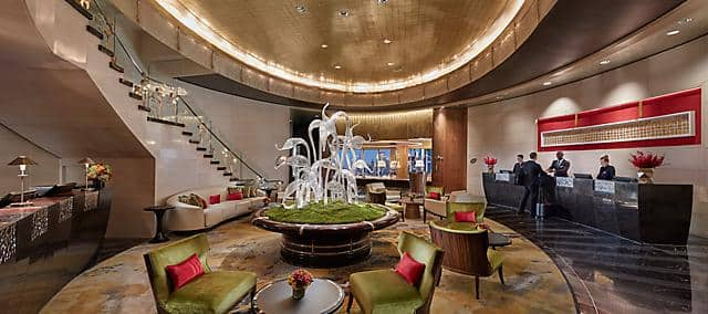 hotel lobby with crystal sculptures and green tone seating