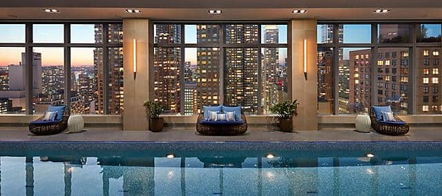 pool with blue mosaic overlook buildings in manhattan