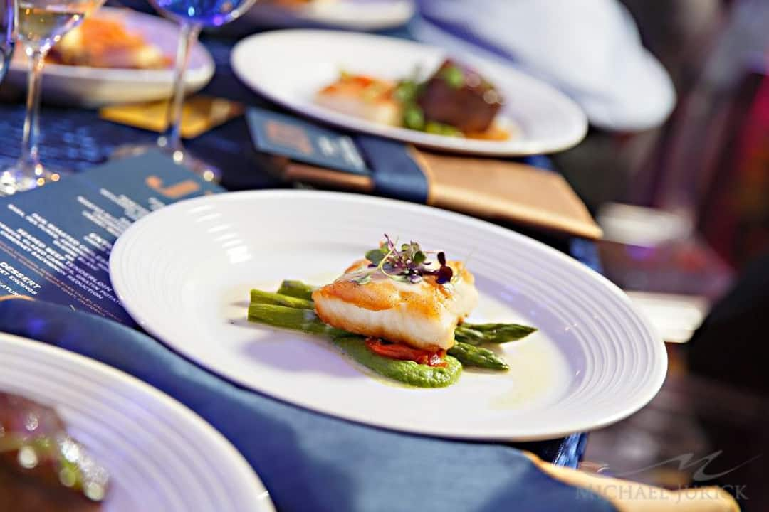 a dish of fish filet and asparagus