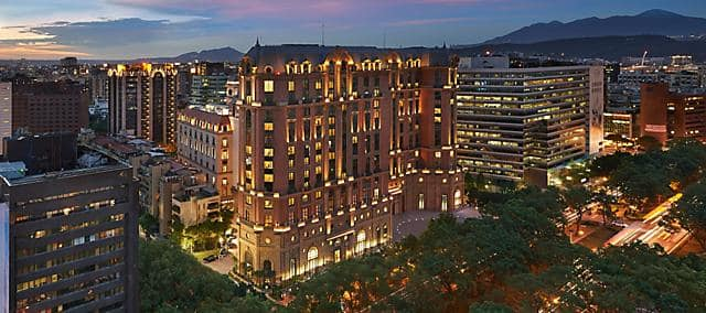 The illuminated exterior of Mandarin Oriental, Taipei, at dusk