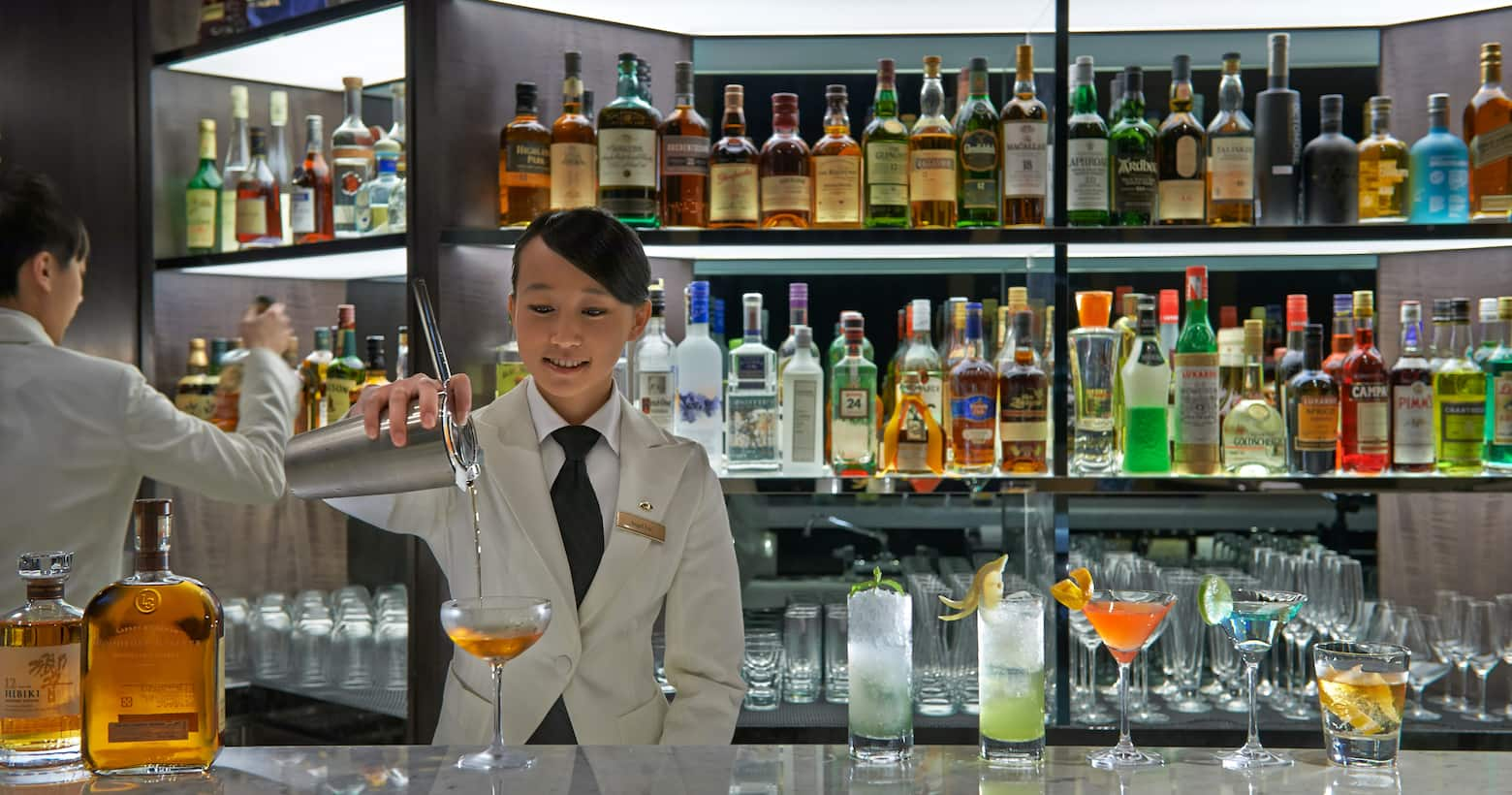bartending serving cocktail at mo bar