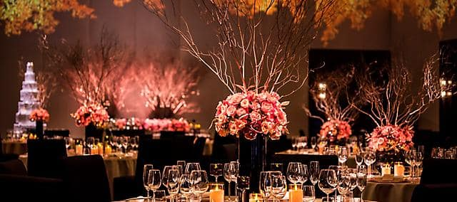 ballroom with banquet table setting in orange theme