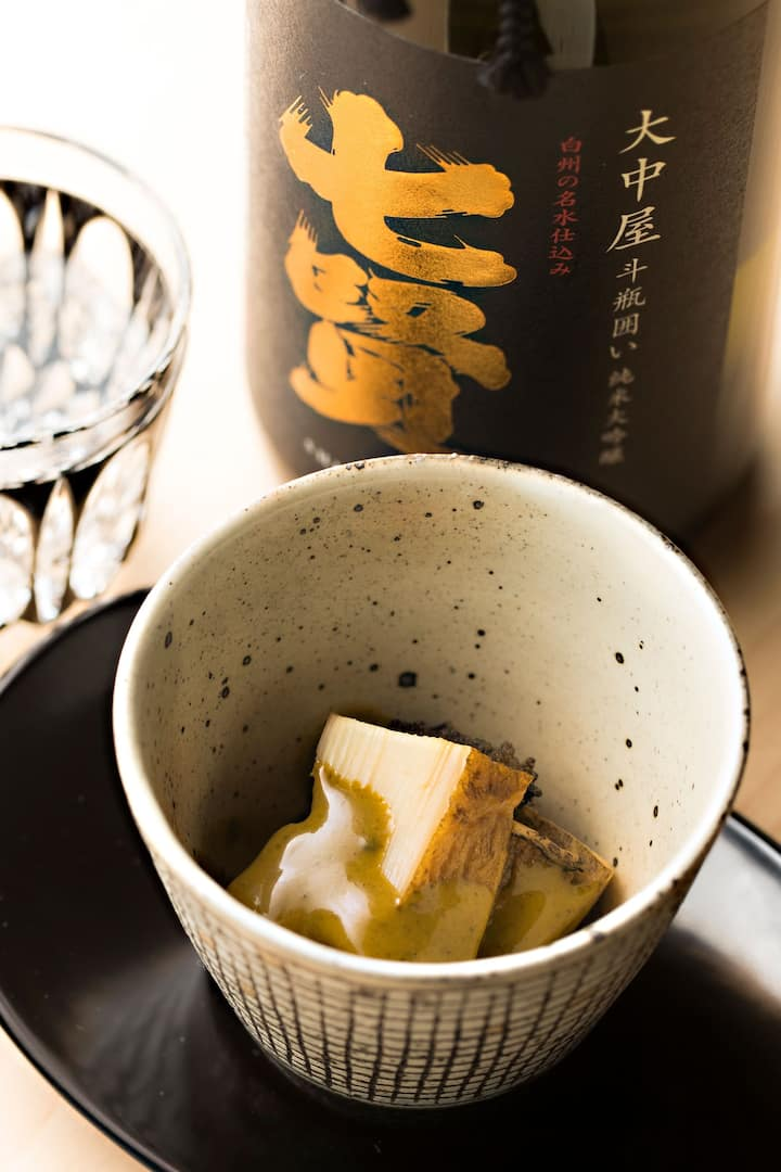 Sake in a bowl on a dish