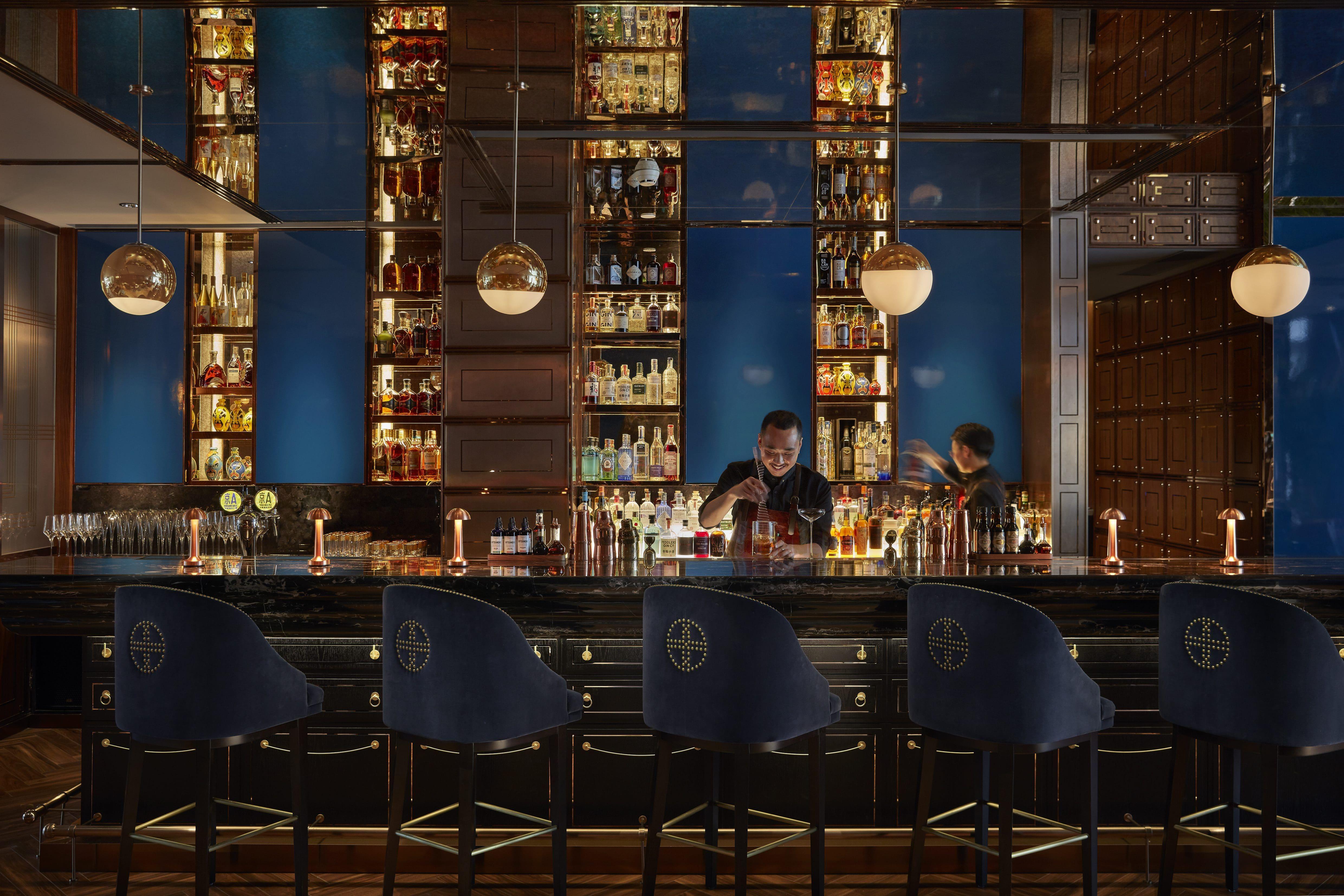 Bartender at work at MO Bar