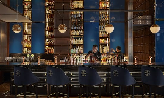 Bartender prepares a drink at MO Bar at Mandarin Oriental Wangfujing, Beijing