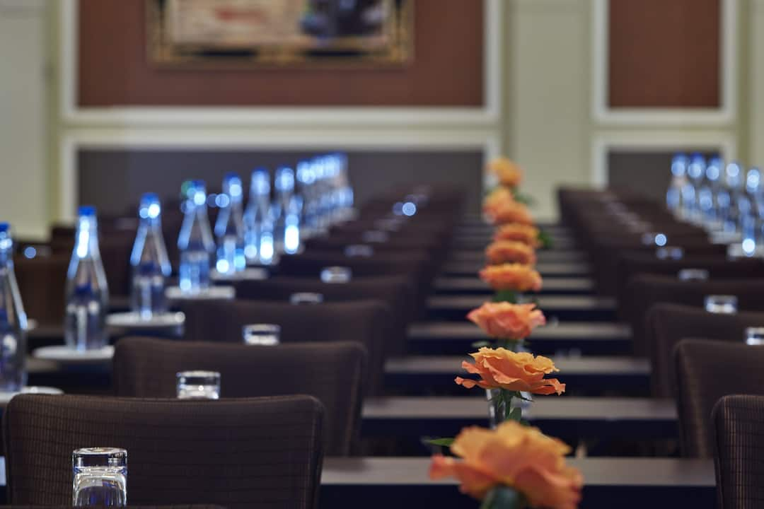 meeting room with dark brown table and chairs