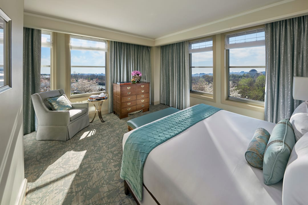 executive water view bedroom with large windows