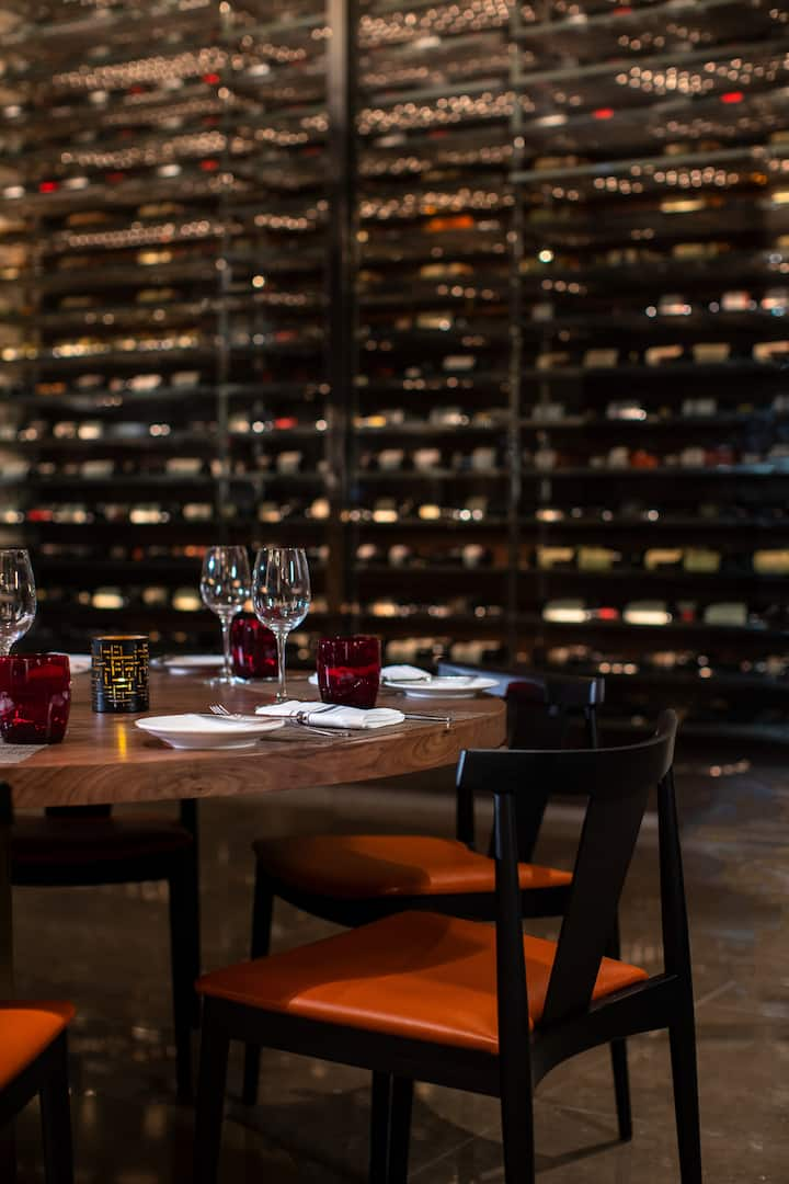 amit interior dining area with a wall of wine